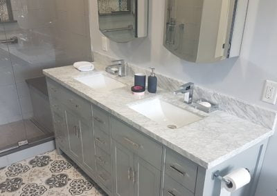 Double Sink Vanity Cabinet with art décor tiles on the floor