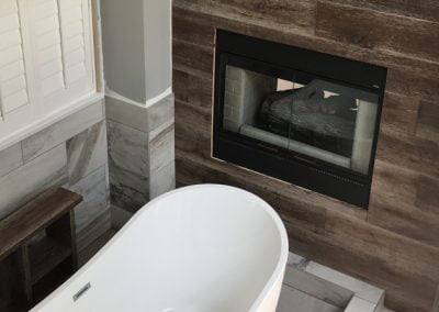 Full Bathroom Renovation with fireplace wood panelling, free standing tub with custom moat drain
