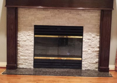 Custom Fireplace Mantle with ledge stone inlay and granite hearth